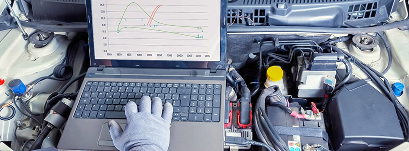Open engine bonnet with hand and notebook
