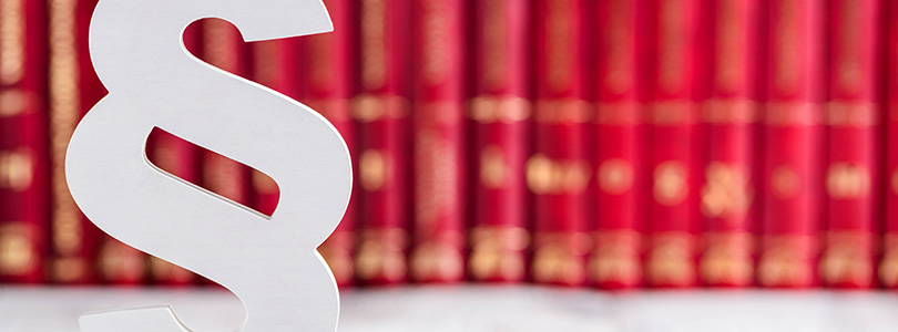 White legal paragraph symbol in front of red books