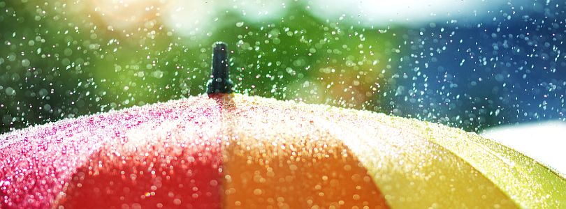Rain splashing on a colourful umbrella