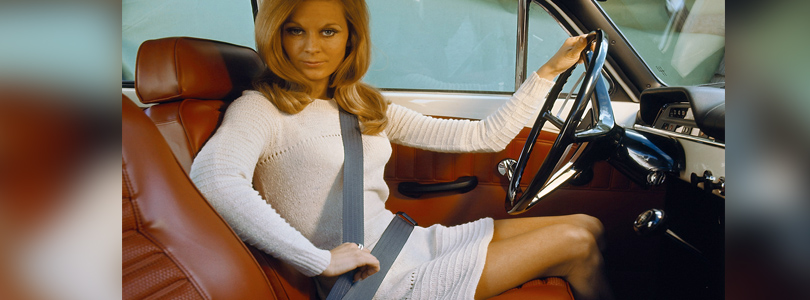 Woman with seat belt, Volvo advertisement, ca. 1970