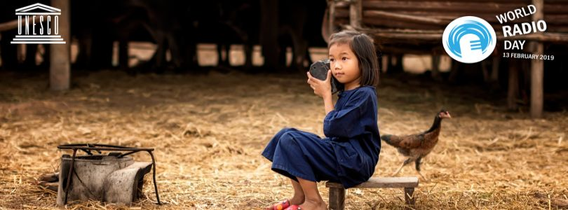 Kid with radio in Asia